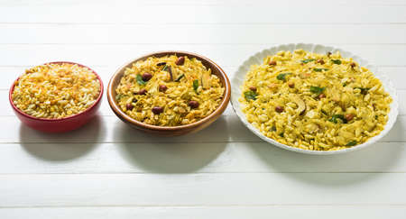 sev: Indian traditional and popular snack poha chivda or chivada made from frying items like thin flattened rice, red chili, curry leaves, groundnuts, cashew nuts and almonds. selective focus