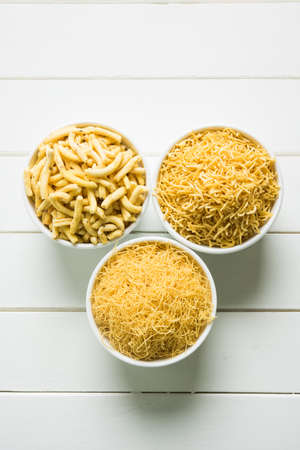 stock photo of Sev Namkeen Food Collection Aloo Sev also know as namkin and nimco a popular crisp savory snack made from mashed potatoes, chickpea flour and spices Stock Photo