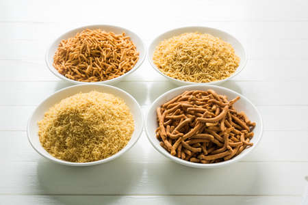sev: stock photo of Sev Namkeen Food Collection Aloo Sev also know as namkin and nimco a popular crisp savory snack made from mashed potatoes, chickpea flour and spices Stock Photo
