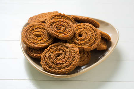 murkoo: Stock Photo of Chakli or Chakali or Murukku, popular salty food made during diwali festival