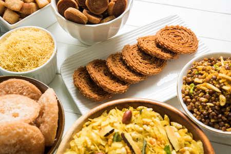 sev: stock photo of  Diwali food or Diwali snacks or Diwali sweets like anarsa, bakarvadi, chakli, sev, bhujiya, shankar pale and chivda or chiwada, karanji, favourite indian diwali recipe, selective focus