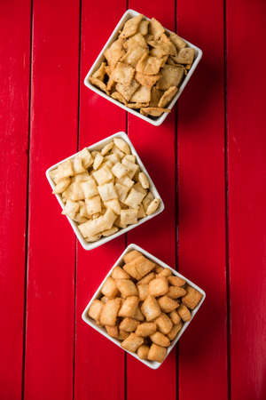 combination: stock photo of  variety of Shakkar pare Also Know as Shakkarpare, Shakarpali, Shakkar Para, or Shankarpalli or shankar pale is a Snack Typically Made in India During Diwali Stock Photo