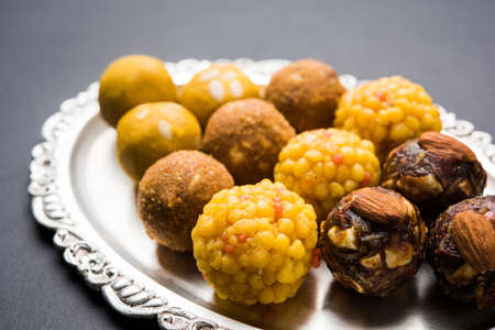 Stock photo of variety of sweet laddu or laddoo or ladu, a sweet dumpling made up of bundi, dry fruits or rava, selective focus Stock Photo