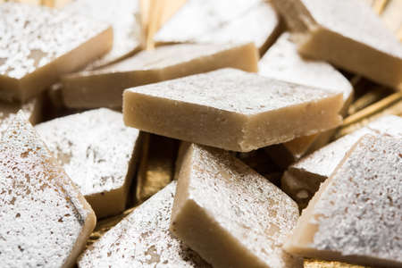 Stock photo of Kaju Katli, a popular indian sweet burfi made using milk, khoya, cachew and Sugar Stock Photo