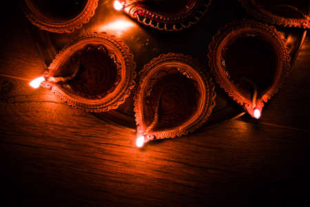 Diya in Thali - Brass Plate or thali full of Terracotta diya or oil lamps ready for decorating or illuminating house on diwali, a festival of light. selective focus