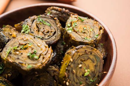 maharashtra: Patra or Paatra or Alu Vadi is a popular maharashtrian and Gujrati snack recipe made using colocasia leaves, rice flour and flavourings spices, tamarind, and jaggery, selective focus