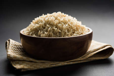 Stock Photo of cooked Brown Basmati rice served in a bowl, selective focus Foto de archivo