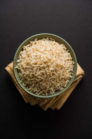 Stock Photo of cooked Brown Basmati rice served in a bowl, selective focus Stock Photo