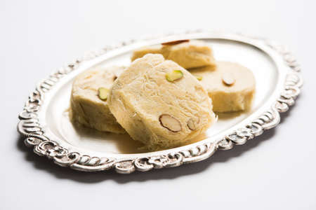 Stock photo of Soan Papdi or Soan roll or Patisa or patisha, popular sweet from India. selective focus Stock Photo
