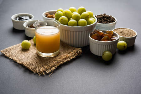 Stock photo of Amla/Avla/Aavla and it's by products like chyawanprash or chyavanprash, juice, Amla supari or mouth freshner, powder, juicy or dried sweet murabba or muramba, pickle, selective focus