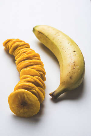 platanos fritos: Stock Photo of Healthy Homemade Kela or Banana chips or wafers or Plantain Chips, selective focus