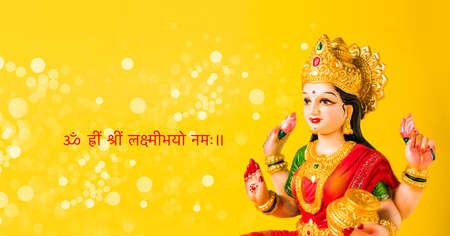 Idol worshipping of Hindu Goddess Lakshmi - Lakshmi Puja is a Hindu religious festival that falls on Amavasya (new moon day) which is  the third day of Tihar or Deepawali Stock Photo