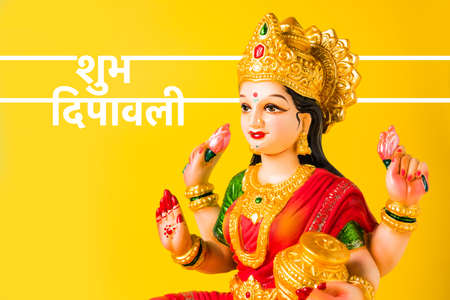 Idol worshipping of Hindu Goddess Lakshmi - Lakshmi Puja is a Hindu religious festival that falls on Amavasya (new moon day) which is  the third day of Tihar or Deepawali Stock Photo