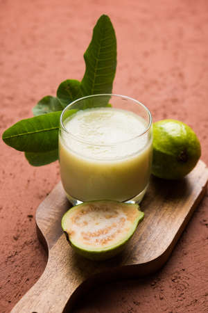 guayaba: Guava  juice or Amrud drink or Smoothie with fresh Guava fruit, moody lighting selective focus