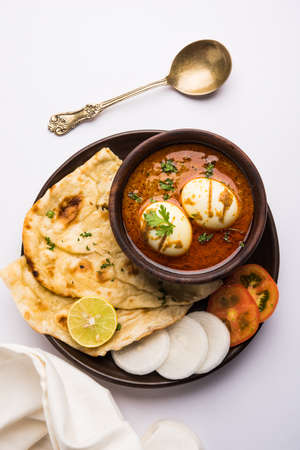 Anda Curry or Egg Curry or Egg masala gravy, indian spicy food or recipe, served with roti or naan, selective focus Stock Photo