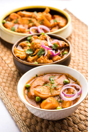 Aloo Gobi matar is a famous Indian curry dish with potatoes and cauliflower and green peas, selective focus Stock Photo