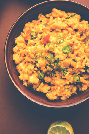 Pithla Bhakar or spicy besan curry or zunka is a popular food recipe made up of Gram flour and jowar flour from Maharashtra India Stock Photo