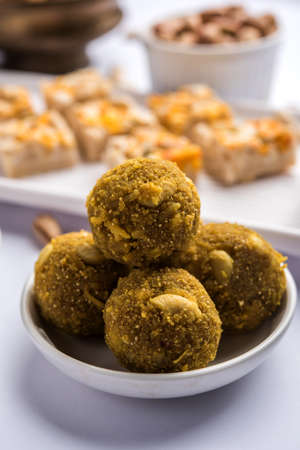 Indian sweet food group photo. Dry fruit laddu, kaju katli or kaju burfi, gajak or til papdi, rasmalai or Rasmalai, gulab jamun