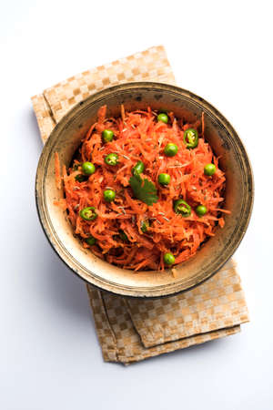 Carrot raita  Gajar Koshimbir. It a condiment from the Indian subcontinent, made with or without dahi  curd together with raw  cooked vegetables Gajar  Carrot, green, peas, chilli, coriander