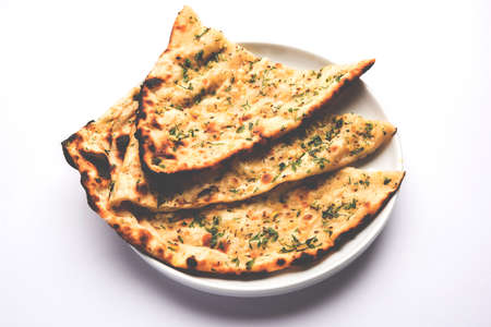 Garlic and coriander naan served in a plate, its a type of Indian bread or roti flavoured with garlic