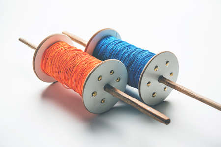 Fikri ReelChakri Spool with colourful thread or manjha or manja for Kite flying in Indian festival called Makar Sankranti which is uttarayan or uttarayana Stock Photo