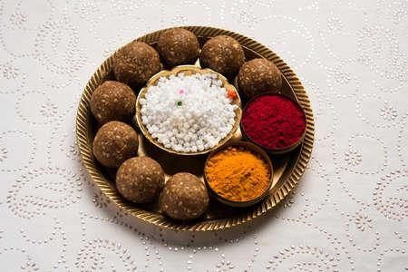 Tilgul or Til Gul with haldi Kumkum and halwachiranji or sugar balls for makar sankranti festival