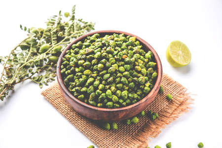 Roasted fresh Green Chickpeas or Chick Peas or harbara in hindi also known as Cicer with pinch of salt and chat masala and lemon, popular snack from Indiaasia Stock Photo