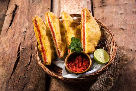 Bread Pakora or Bread Pakoda or bhaji served along with Green Chutney and tomato ketchup. selective focus Stock Photo