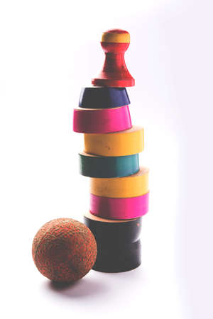 Lagori, dikori or lagoori, also known as Lingocha, Pithu, Pitto, Pittu or Satoliya  is a game in India involving a ball and a pile of flat stones or wooden chips Stock Photo