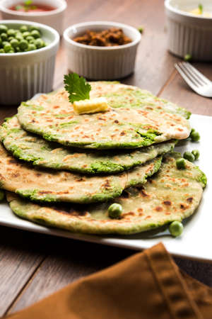 Green peas stuffed paratha or matar ka paratha, which is a traditional and popular food native to north India, made from dough of wheat flour and green peas or matar, served with mango pickle