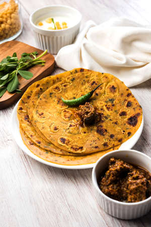 Methi Paratha (Thepla)  Indian flat bread using fenugreek leaves, selective focus Stock Photo