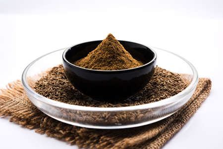 cumin seeds or Jeera powder (Ground cumin ), selective focus