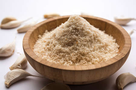 Garlic powder is ground, dehydrated garlic. Its a common seasoning  for pasta, pizza and grilled chicken. Stock Photo