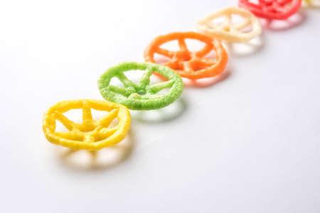 wheel shape colourful fryums papad snack. selective focus