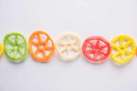 wheel shape colourful fryums papad snack. selective focus