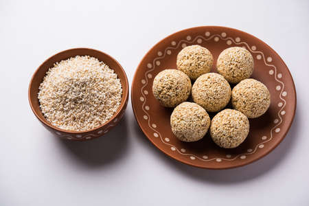 Amaranth or rajgira lahi in a bowl with sweet laddu. selective focus