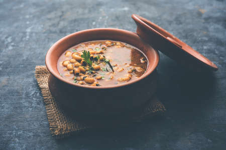 Black Eyed Kidney Beans Curry or Chawli chi usal / masala, served in a ceramic bowl over moody background, selective focus