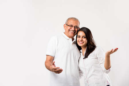 old Indian father with young girl standing isolated over white background Stock Photo