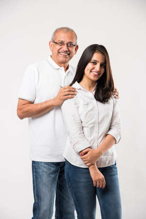 old Indian father with young girl standing isolated over white background Archivio Fotografico