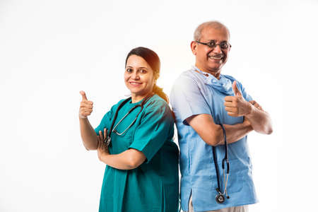 two Indian/asian surgeons / doctors standing isolated over white background