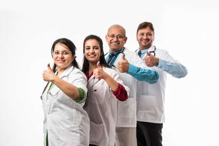 Indian/asian doctors group photo showing success/thumbs up sign. standing isolated over white background. selective focus 免版税图像 - 119716766