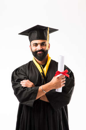education, graduation and people concept - happy Indian Male graduate student in mortarboard and bachelor gown Banco de Imagens - 122791498