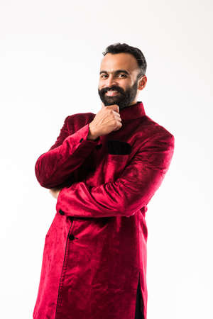 Portrait of Cheerful bearded Indian Man in traditional wear showing success or confidence, selective focus