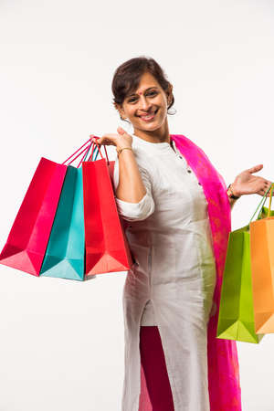 Indian ladywomen with shopping bag, standing isolated over white background