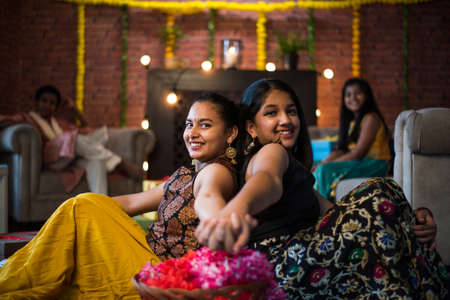 Indian Kids celebrating Diwali with family