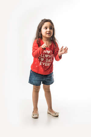 Indian small girl standing in style isolated over white background Stock Photo