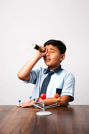 Boy studying Planets or planetary science with 3d Model of our solar system