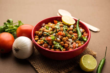 Black Chickpea Chaat or Kala Chana Chat recipe is a popular snack recipe from India, served in a bowl. selective focus Stock Photo