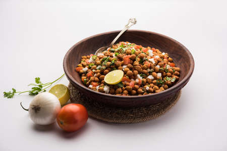 Black Chickpea Chaat or Kala Chana Chat recipe is a popular snack recipe from India, served in a bowl. selective focus