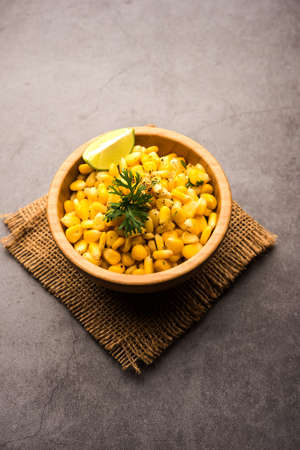 Spicy Masala Sweet Corn is a tasty roadside Indian snack, which is very easy to make. selective focus